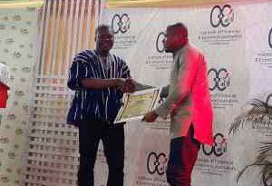 Masahudu Ankiilu Kunateh, the overall winner receiving his award from Prof John Gatsi
